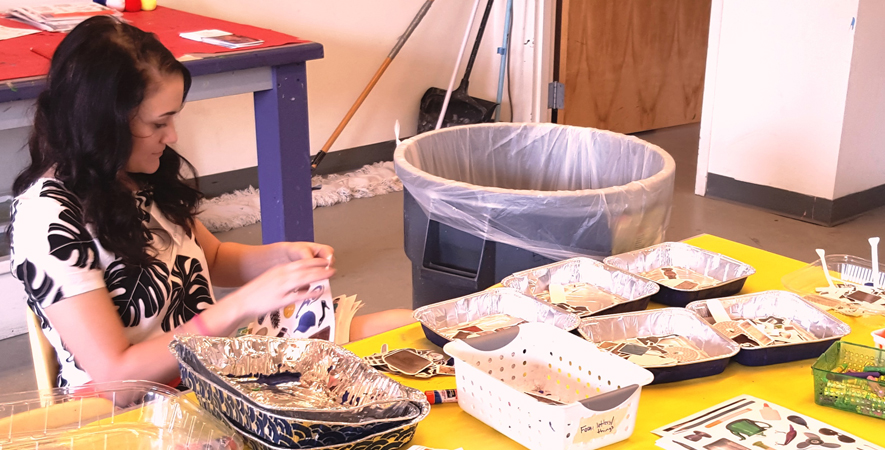 Volunteer Ashley Hardin Prepares Collage Materials a
