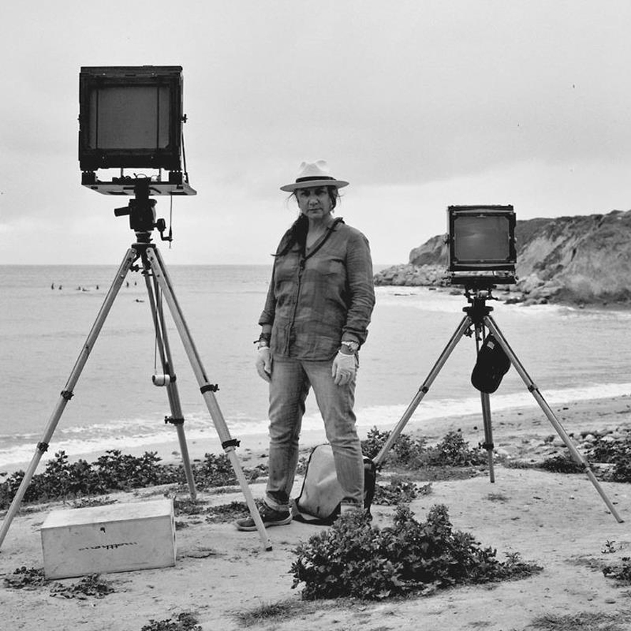 Joni Sternbach on Beach with Two Cameras