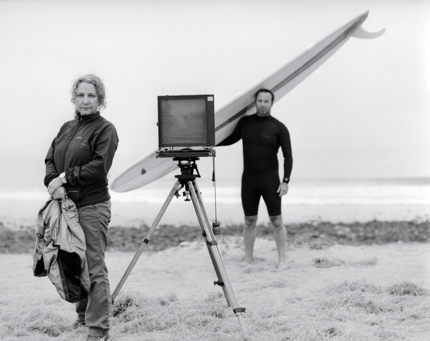 Joni Sternbach on Beach with Camera and Surfer