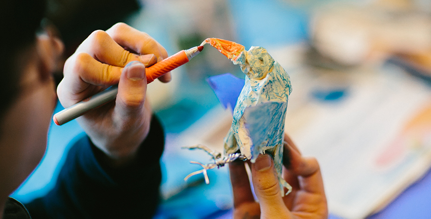 A Student Puts the Finishing Touches on His Art Fusion Bird
