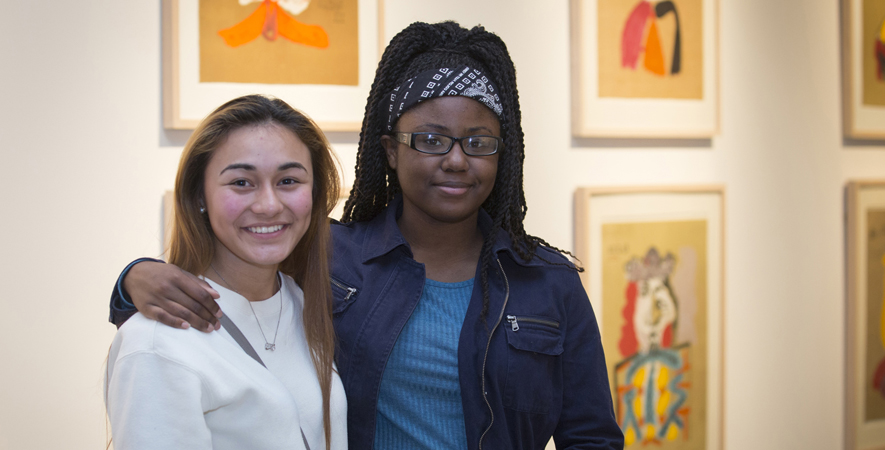 Two Students Smile for the Camera at Art Walk