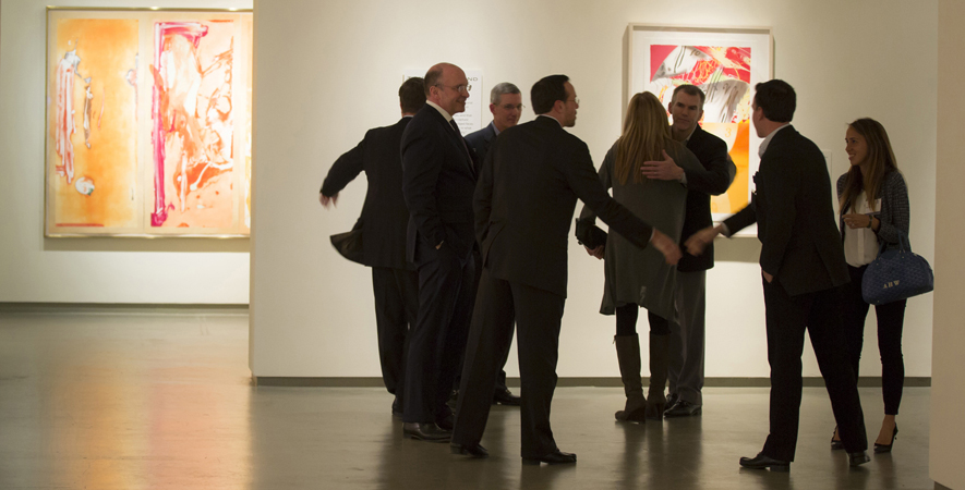 Patrons Greet Eachother at a MOCA Jacksonville Preview Event