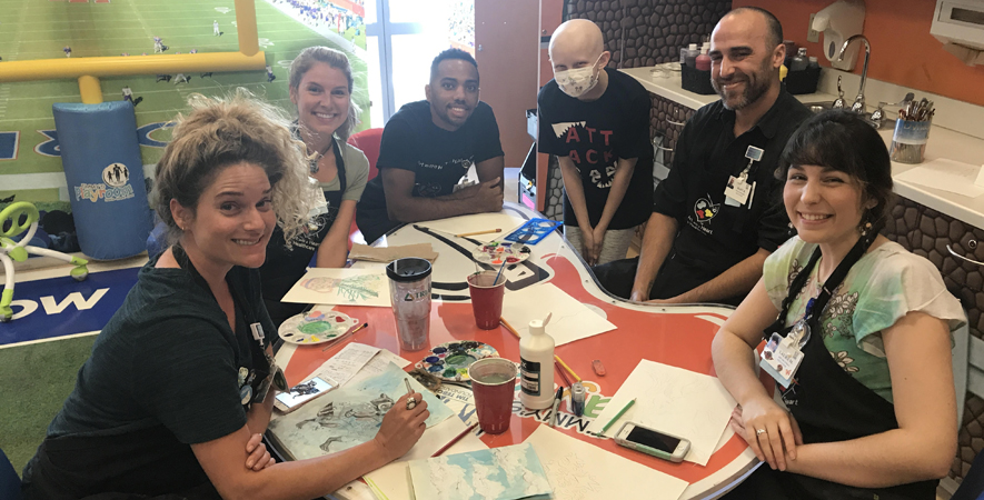 Bella works with Art with a Heart in Healthcare artists