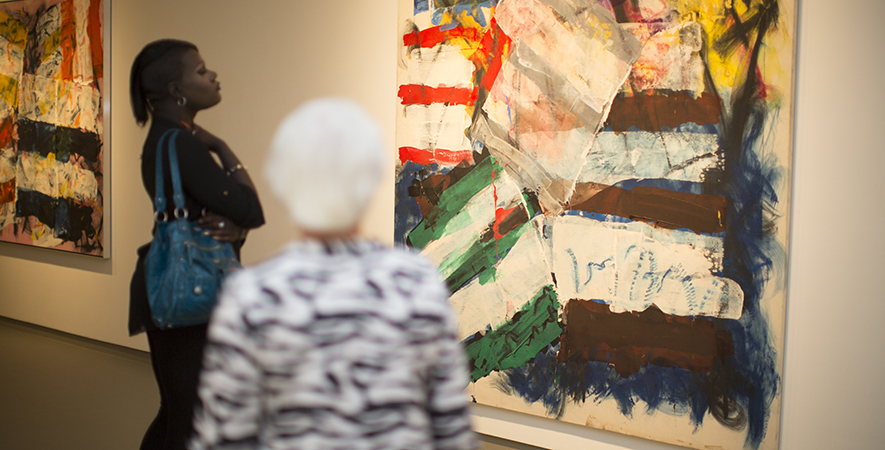 Patrons Tour the Galleries During Abstraction over Time: The Paintings of Michael Goldberg