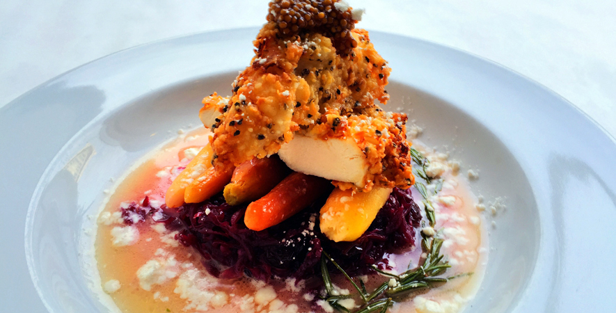 Fried Chicken with braised red cabbage, apple-rosemary-glazed baby rainbow carrots, crispy buttermilk fried chicken breast, pickled mustard seeds, bacon powder